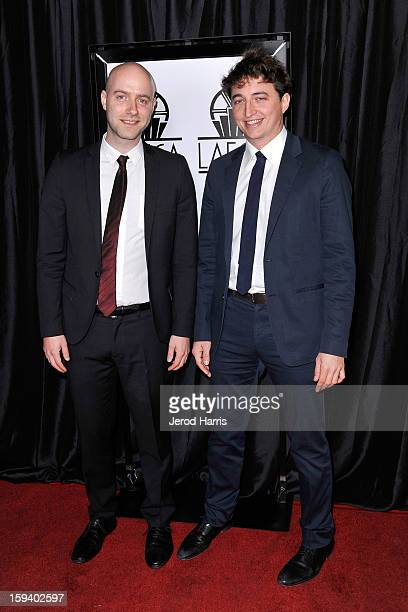 Director Benh Zeitlin and producer Dan Romer arrive at the 38th Annual Los Angeles Film Critics Association Awards at InterContinental Hotel on...