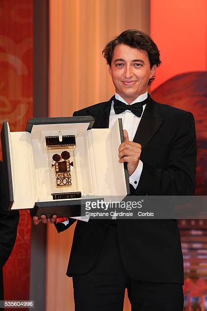 Director Benh Zeitlin holds the Camera d'Or for 'Beasts Of The Southern Wild' onstage at the Closing Ceremony during the 65th Annual Cannes Film...