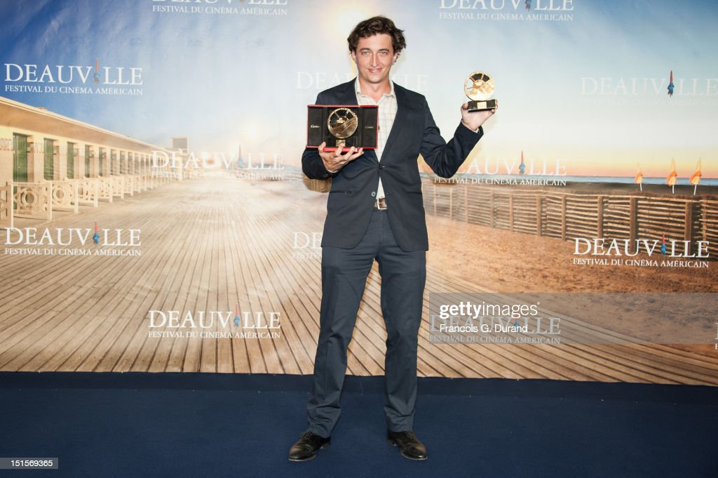 Director Benh Zeitlin poses with its trophies after the closing ceremony of the 38th Deauville American Film Festival on September 8, 2012 in Deauville, France.