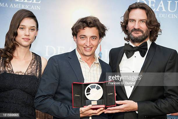 Director Benh Zeitlin poses with the jury 'Revelation Cartier' after the closing ceremony of the 38th Deauville American Film Festival on September 8...