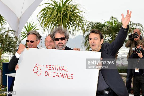 Director Benoit Delepine actors Benoit Poelvoorde Gustave Kervern and Albert Dupontel pose at the 'Le Grand Soir' photocall during the 65th Annual...