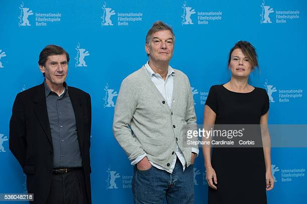 Director Benoit Jacquot and producers Jean Pierre Guerin and Kristina Larsen attend the 'Diary of a Chambermaid' photocall during the 65th Berlinale...