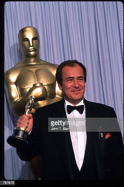 Director Bernardo Bertolucci holds his Best Director Oscar for The Last Emperor at the Academy Awards April 11 1988 in Los Angeles CA The Academy...