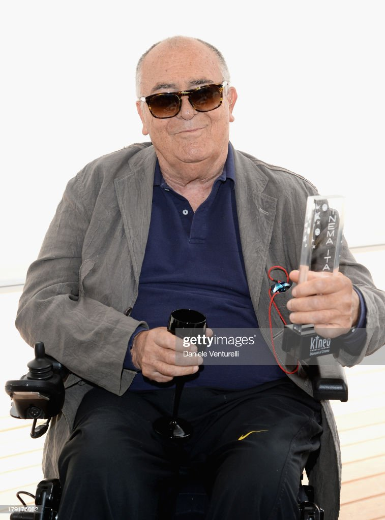 Director Bernardo Bertolucci poses with Kinéo 2013 award at Premio Kineo Photocall during the 70th Venice International Film Festival at Terrazza Maserati on September 1, 2013 in Venice, Italy.