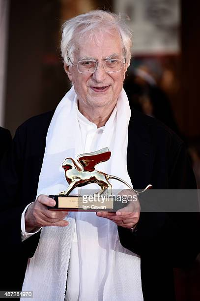 Director Bertrand Tavernier poses with his Golden Lion For Lifetime Achievement 2015 ah he attends the premiere of 'Life And Nothing Else' and...
