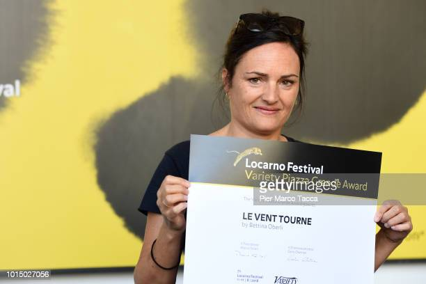 Director Bettina Oberli pose with Variety Piazza Grande Award at the Palmares photocall during the 71st Locarno Film Festival on August 11 2018 in...