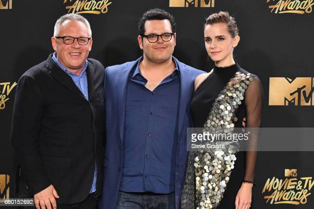 Director Bill Condon and actors Josh Gad and Emma Watson, winners of Movie of the Year for 'Beauty and the Beast', pose in the press room at the 2017...