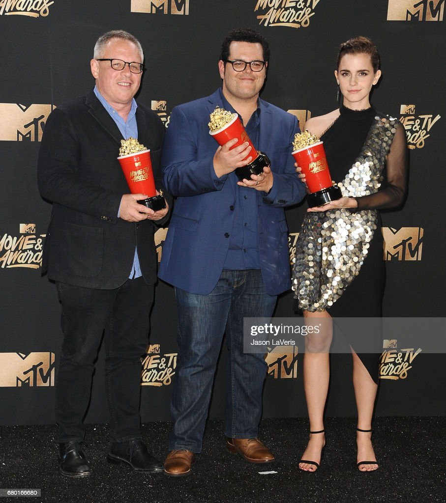 Director Bill Condon and actors Josh Gad and Emma Watson, winners of Movie of the Year for 'Beauty and the Beast', pose in the press room at the 2017 MTV Movie and TV Awards at The Shrine Auditorium on May 7, 2017 in Los Angeles, California.