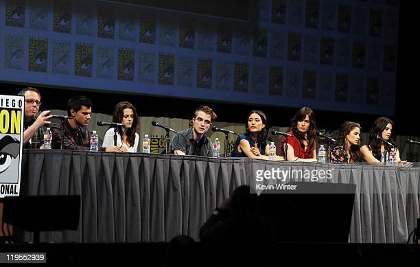 Director Bill Condon and actors Taylor Lautner Kristen Stewart Robert Pattinson Julia Jones Elizabeth Reaser Nikki Reed and Ashley Greene speak at...