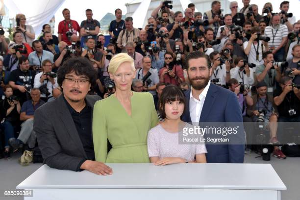 Director Bong JoonHo Actors Tilda Swinton Ahn SeoHyun and Jake Gyllenhaal attend the Okja photocall during the 70th annual Cannes Film Festival at...