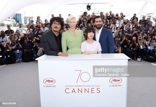 Director Bong JoonHo actors Tilda Swinton Ahn SeoHyun and Jake Gyllenhaal attend the 'Okja' photocall during the 70th annual Cannes Film Festival at...