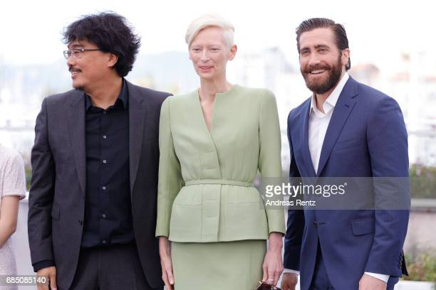 Director Bong JoonHo actors Tilda Swinton and Jake Gyllenhaal attend the Okja photocall during the 70th annual Cannes Film Festival at Palais des...