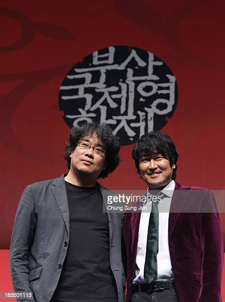 Director Bong JoonHo and actor Song KangHo attend the Gala Presentation 'Snowpiercer' Press Conference at the Shinsegae Centumcity during the 18th...