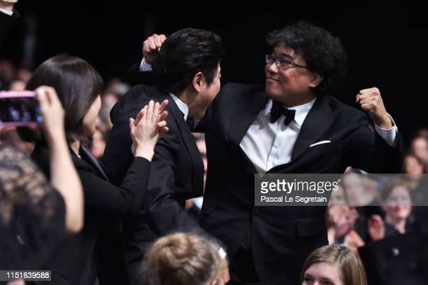Director Bong JoonHo reacts after winning the Palme d'Or award for Parasite during the Closing Ceremony of the 72nd annual Cannes Film Festival on...