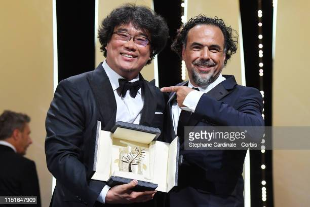 Director Bong JoonHo receives the Palme d'Or award for Parasite form President of the Main competition jury Alejandro Gonzalez Inarritu during the...
