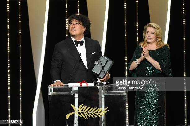 Director Bong JoonHo receives the Palme d'Or award for Parasite from Catherine Deneuve during the Closing Ceremony of the 72nd annual Cannes Film...