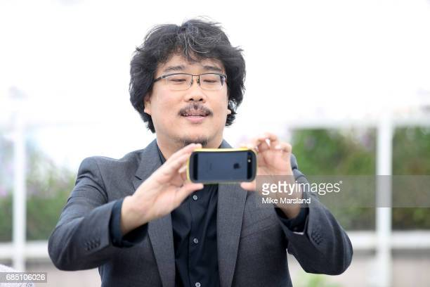 Director Bong JoonHo ttends the 'Okja' photocall during the 70th annual Cannes Film Festival at Palais des Festivals on May 19 2017 in Cannes France