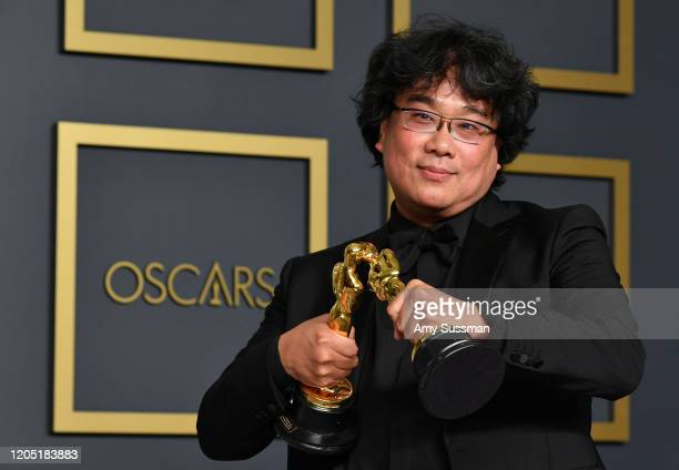 """Director Bong Joonho winner of the Original Screenplay International Feature Film Directing and Best Picture awards for """"Parasite"""" poses in the press..."""