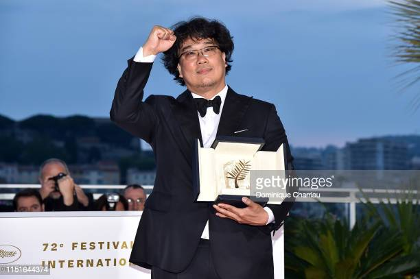Director Bong JoonHo winner of the Palme d'Or award for his film Parasite poses at thewinner photocall during the 72nd annual Cannes Film Festival...