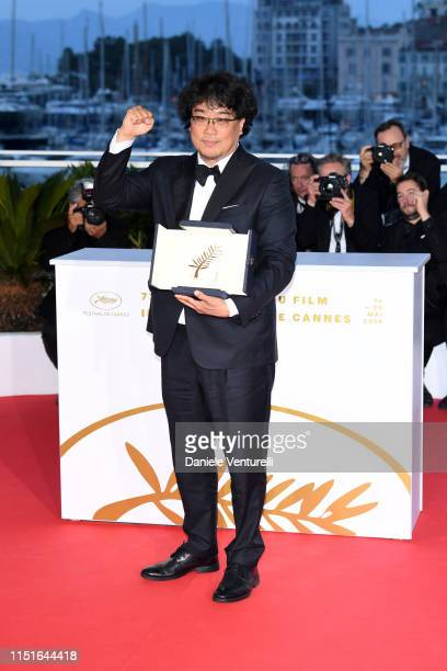 Director Bong JoonHo winner of the Palme d'Or award for his film Parasite poses at the winner photocall during the 72nd annual Cannes Film Festival...