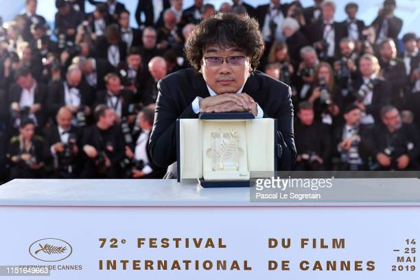 "Director Bong Joon-Ho, winner of the Palme d'Or award for his film ""Parasite"" poses at the winner photocall during the 72nd annual Cannes Film..."