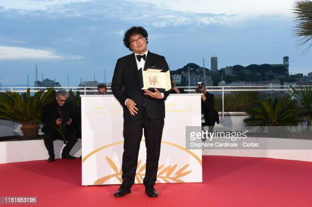 Director Bong JoonHo winner of the Palme d'Or award for his film Parasite poses at the photocall for Palme D'Or Winner during the 72nd annual Cannes...