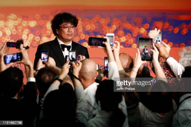 Director Bong JoonHo winner of the Palme d'Or award for his film Parasite speaks at the Closing Ceremony Press Conference during the 72nd annual...