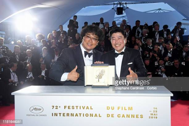 Director Bong JoonHo winner of the Palme d'Or award for his film Parasite poses with Actor KangHo Song at thewinner photocall during the 72nd annual...