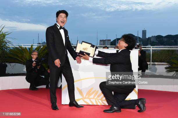 Director Bong JoonHo with KangHo Song winner of the Palme d'Or award for his film Parasite poses at the photocall for Palme D'Or Winner during the...