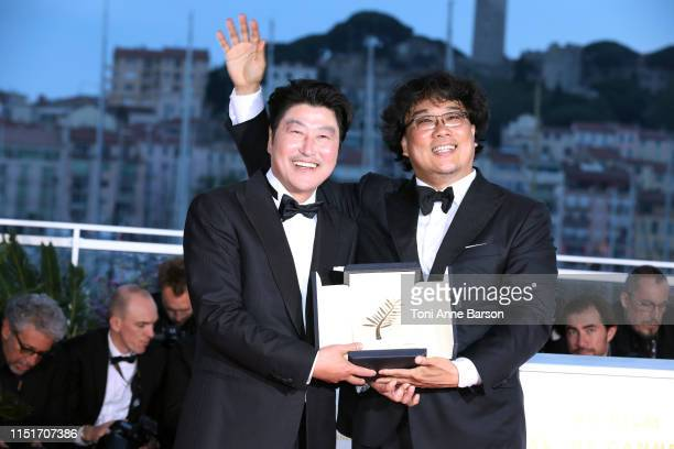 Director Bong JoonHo with KangHo Song winner of the Palme d'Or award for his film Parasite pose at thephotocall for Palme D'Or Winner during the...