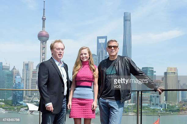 Director Brad Bird actress Britt Robertson and actor George Clooney attend 'Tomorrowland' photocall at The Bund on May 22 2015 in Shanghai China