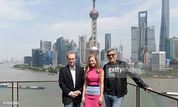 Director Brad Bird actress Brittany Robertson and actor George Clooney attend 'Tomorrowland' photocall at The Bund on May 22 2015 in Shanghai China