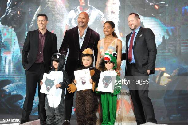 Director Brad Peyton actor Dwayne Johnson actress Naomie Harris and producer Beau Flynn attend 'Rampage' premiere at Shanghai Film Art Center on...