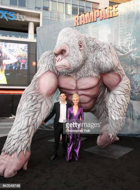 Director Brad Peyton and Breanne Hill attend the premiere of Warner Bros Pictures' 'Rampage' at Microsoft Theater on April 4 2018 in Los Angeles...