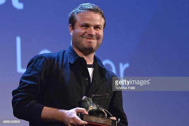 Director Brady Corbet holds the Orizzonti award for Best Director for his movie 'The Chilhood of a Leader' during the awards ceremony on the closing...