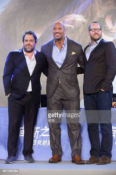 """Director Brett Ratner, actor Dwayne Johnson and producer Beau Flynn attend a press conference for the new movie """"Hercules"""" on October 16, 2014 in..."""