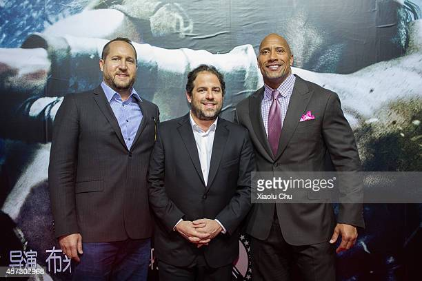 Director Brett Ratner and actor Dwayne Johnson and Producer Beau Flynn attend the Chinese Premiere of Hercules at the Wanda CBD on October 16, 2014...
