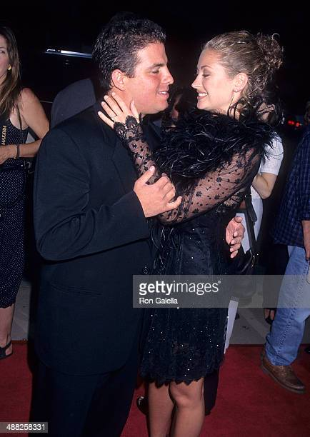 Director Brett Ratner and actress Rebecca Gayheart attend the 'Money Talks' Hollywood Premiere on August 19 1997 at the Cinerama Dome Theatre in...