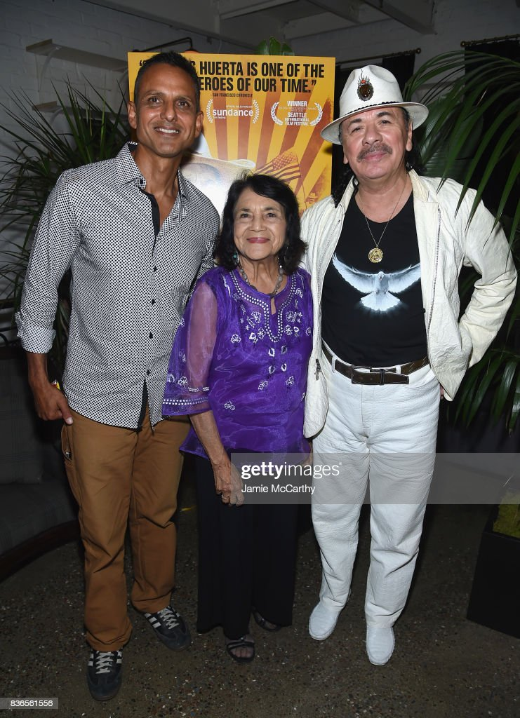Director Brian Bratt, Delores Heurta and Executive Produser Carlos Santana attend the 'Dolores' New York Premiere after party at The Metrograph on August 21, 2017 in New York City.