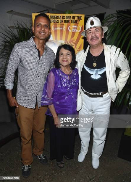 Director Brian Bratt Delores Heurta and Executive Produser Carlos Santana attend the 'Dolores' New York Premiere after party at The Metrograph on...