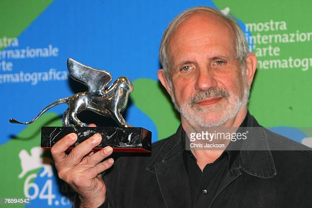 Director Brian de Palma holds the Silver Lion award for his film Redacted at the Leone d'Oro del 75th closing ceremony photocall in Venice during day...