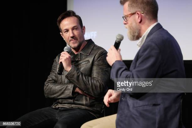 Director Bryan Fogel and SCAD professor Michael J Chaney onstage at 'Icarus' QA during 20th Anniversary SCAD Savannah Film Festival on October 30...