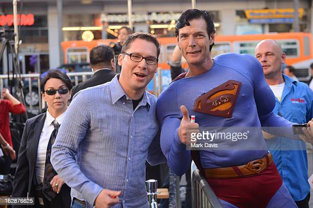Director Bryan Singer and a fan in a costume attend the Jack The Giant Slayer footprint ceremony held at the TCL Chinese Theatre on February 28 2013...