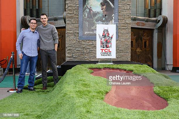 Director Bryan Singer and actor Nicholas Hoult attend the unveiling of a giant footprint for 'Jack the Giant Slayer' at TCL Chinese Theatre on...