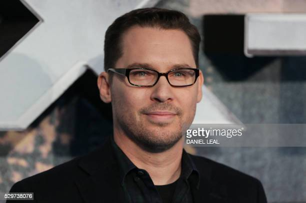 US director Bryan Singer poses on arrival for the premiere of XMen Apocalypse in central London on May 9 2016 / AFP / DANIEL LEALOLIVAS