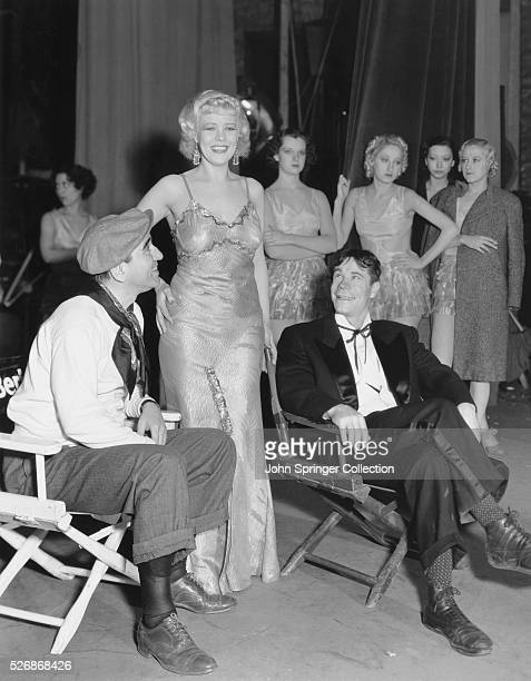 Director Busby Berkeley actress Esther Burke and actor Joe E Brown relax backstage