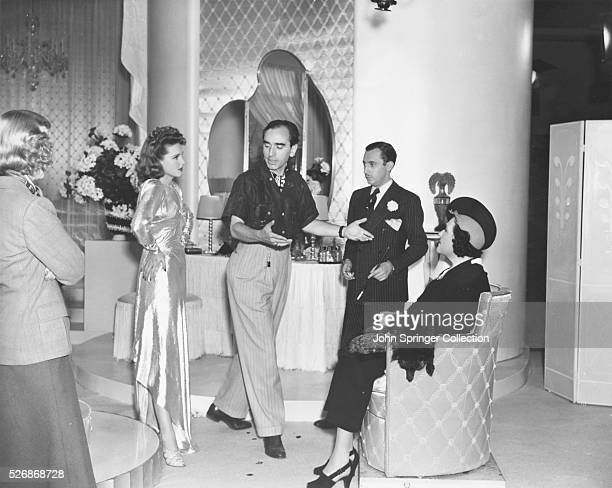 Director Busby Berkeley shows how he wants a scene played in the Warner Bros 1938 film Hollywood Hotel Actors and actresses Glenda Farrell Lola Lane...