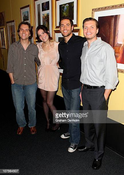 Director Byron Howard Mandy Moore Zachary Levi and Director Nathan Greno pose at the 'Tangled' section of the Disney classic fairy tales exhibition...