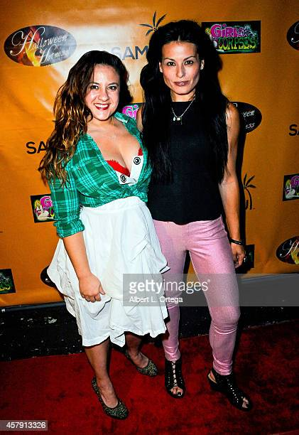Director Caitlin Kazepis and actress Alexis Iacono attend Halloween Hotness Costume Party held at Couture on October 25 2014 in Hollywood California