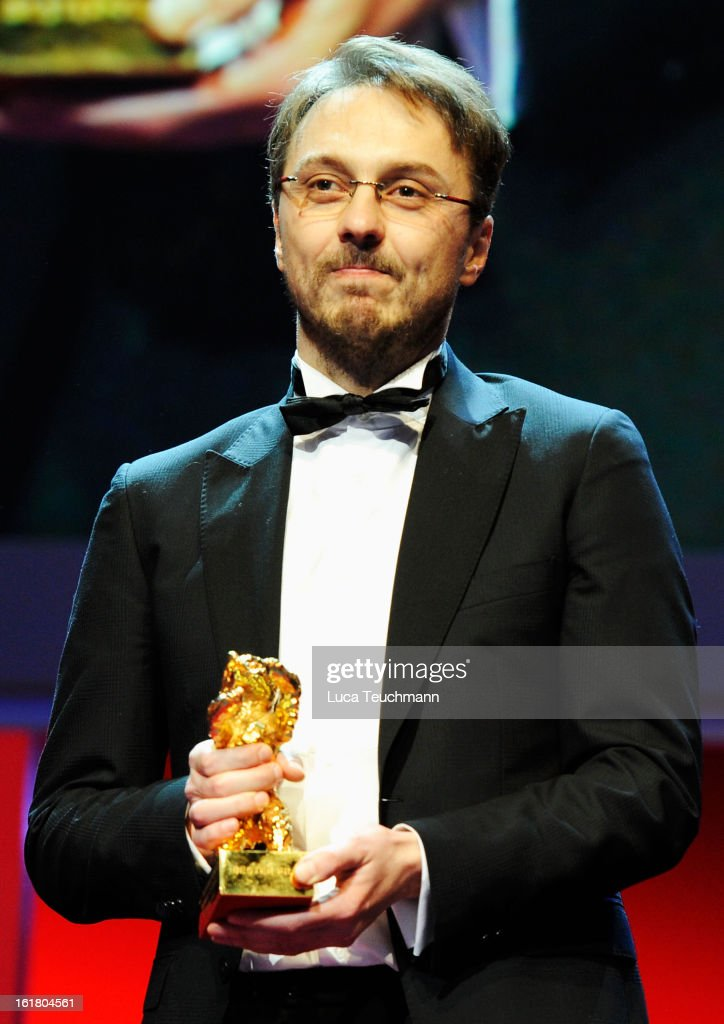 Director Calin Peter Netzer on stage after receiving the Golden Bear at the Closing Ceremony during the 63rd Berlinale International Film Festival at Berlinale Palast on February 14, 2013 in Berlin, Germany.